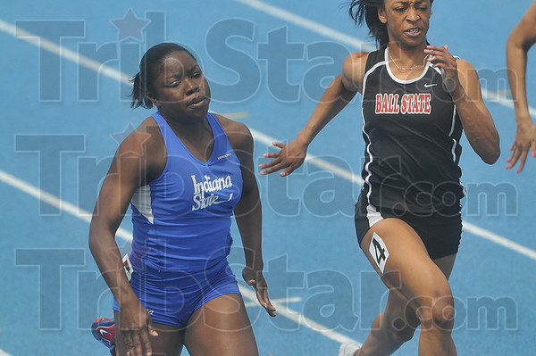 Tribune-Star/Joseph C. Garza<br /> NCAA qualifier: Indiana State's Jeanne Middleton leads all competitors as she competes in the 100-meter dash Saturday during the Pacesetter Invitational at Marks Field.