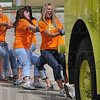 Tribune-Star/Joseph C. Garza<br /> Sisters in the Alpha Sigma Alpha sorority at Indiana State University give it their all to pull a fire truck during the Pi Kappa Alpha 2009 Fire Truck Pull fundraiser Saturday at the Terre Haute International Airport-Hulman Field.