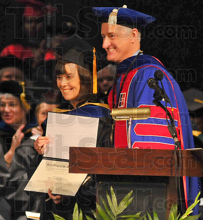Outstanding: Mary Pat Kelly of the class of 1967 recieved the SMWC Distinguished Alumni Award from President David G. Behrs at the 168th Commencement exercise Saturday afternoon.