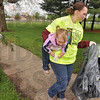 Tribune-Star/Joseph C. Garza<br /> A mother's work is never done even when volunteering, like in the case of Danette Monson as she tries to keep Terre Haute beautiful with her hands (or at least one arm) full with one-year-old daughter, Azabelle Monson, Saturday on Sixth Avenue. With Monson are fellow Jesus Christ of Latter Day Saints church members, Noah Smithson and Harley Smithson.