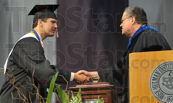 "Tribune-Star/Joseph C. Garza<br /> ""World class student"": Rose-Hulman graduate Evan Breedlove is congratulated by Professor of electrical and computer engineering Keith Hoover after Breedlove was named the 2009 recipient of the Herman A. Moench Distinguished Senior Commendation Saturday during the school's commencement."