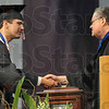 """Tribune-Star/Joseph C. Garza<br /> """"World class student"""": Rose-Hulman graduate Evan Breedlove is congratulated by Professor of electrical and computer engineering Keith Hoover after Breedlove was named the 2009 recipient of the Herman A. Moench Distinguished Senior Commendation Saturday during the school's commencement."""