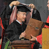 Tribune-Star/Joseph C. Garza<br /> Honorary degree: Governor Mitch Daniels stands ready to receive his honorary Doctor of Humane Letters hood from Rose-Hulman Board of Trustees Vice Chair, William Fenoglio, as President Gerald Jakubowski presents the degree Saturday during the engineering school's commencement.