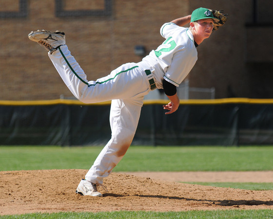 Baseball ballet: West Vigo's #22 Scott West watches the flight of the ball to the plate during game action against Greencastle Saturday afternoon.