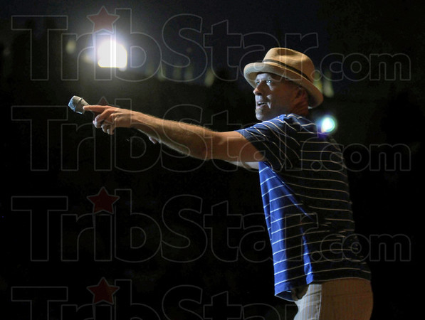 Interaction: Sawyer Brown holds the microphone for the audience to participate in one of his songs during Friday's concert at Fairbanks Park.