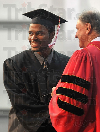 Tribune-Star/Joseph C. Garza<br /> One for the scrapbook: Rose-Hulman graduate Lorenzo Rice poses for a photo with President Gerald Jakubowski as he accepts his degree Saturday during the Rose-Hulman commencement.