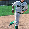 Round tripper: West Vigo's #32, Jeremy Lucas rounds third base enroute to home after a home run during early action against Greencastle Saturday evening.