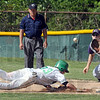 Back: West Vigo's #33, Aaron Welch dives back into first base ahead of the ball during game action Saturday evening. Greencastle's #36 Patrick Richardson waits for the ball.
