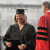 Tribune-Star/Joseph C. Garza<br /> The prize in hand: Rose-Hulman graduate Amanda Ferrell of Alexandria is all smiles after she accepted her degree in chemical engineering from Rose-Hulman President Gerald Jakubowski Saturday during the school's commencement.