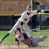 Gotcha: West Vigo shortstop Jordan Pearson shows the ball to the umpire after tagging Greencastle's #10, Justin Bartrum during game action Saturday evening.