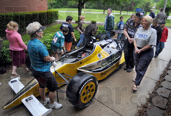Racer: Students and teachers of Lost Creek Elementary School get an up-close look at the King Tut Indy car during a visit Wednesday morning.