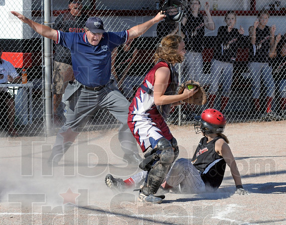 In there: Home plate umpire Jim Haley calls South's #14 Kaylee Criss safe as she scores during game action against Riverton Parke Wednesday evening.