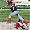 Runner: South's #27, Kaitlyn Pluta jumps over a Riverton Parke infielder enroute to third base during game action Wednesday afternoon.