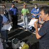 """Tribune-Star/Joseph C. Garza<br /> How to START: Terre Haute Fire Department Paramedic Alan Moore discusses HazMat """"S.T.A.R.T."""" or Single Triage and Rapid Transport with staff members of the Indiana State Student Health Center Wednesday after a mock disaster drill on the college campus."""