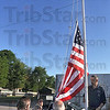 Tribune-Star/Joseph C. Garza<br /> In memory of John Roetker and Maurice Burke, III: County commissioner Judith Anderson raises the flag at the Vigo County Health Department's Vector Control Division on Seventh Avenue Wednesday for Maurice H. Burke, III, and John Roetker. With Anderson are fellow commissioners Paul Mason and Mike Ciolli, along with vector control specialists Warren Sweitzer and Quint Grayless.