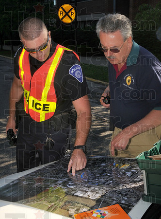 Tribune-Star/Joseph C. Garza<br /> Personnel placement: Indiana State University Police Department Corporal Ian Loomis and University Police Chief Bill Mercier look over where Loomis has assigned personnel during a mock disaster drill Wednesday on the Indiana State campus.