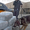 Bales: Indiana State Police K-9 trooper Mike Finney and his dog Sabre located six bales of marijuana on a vehicle during a truck inspection at the weigh station Wednesday afternoon.