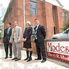 Modesitt move: Members of the Modesitt Law Firm (from left) Chou-il Lee, Terry Modesitt, Tricia Tanoos and Rob Schalburg stand at the front of their temporary offices located at 401 Ohio Street in the Foulkes building.