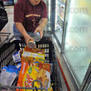 Good stuff: Sandy Linville loads up on items from the freezers at Baesler's Market Thursday evening. Linville won a $500 shopping spree by buying a raffle ticket to help support the Hyte Center.