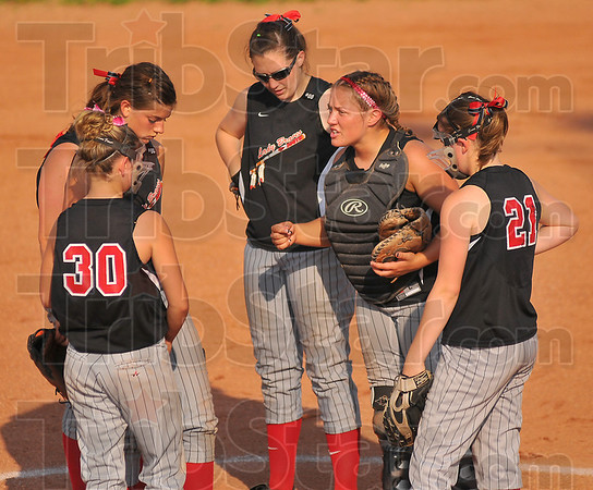 Pep talk: Terre Haute South catcher Tifany Fendrick exhorts her infield after Plainfield had put a couple of runs on the board.