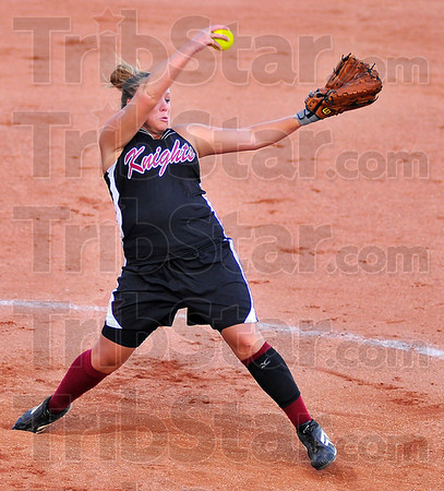Roundup: Knights pitcher        delivers a pitch in the first inning of their sectional matchup with Mooresville.