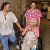 Passionate about nursing: VistaCare CNAs Teal Tippy and Sara Wycoff walk with Davis Gardens resident Anne Lee as nurse Amber Mershon, RN, CHPN, follows behind them Friday at Davis Gardens.