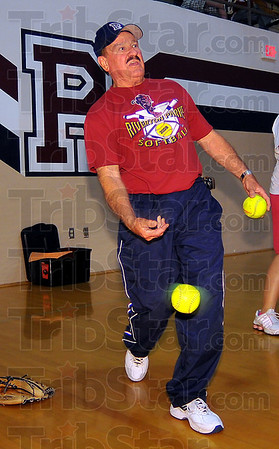 Indoor practice: Riverton-Parke head softball coach Joe Cox throws ground balls to his players so they can practice bare-handed fielding during an indoor practice session last week.