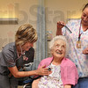 Tribune-Star/Joseph C. Garza<br /> Personal care: Davis Gardens resident Anne Lee, center, is cared for by VistaCare nurse Amber Mershon, RN, and CNA Teal Tippy Friday in Lee's room.