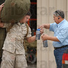 Helping hand: Marine Sgt. Andre Valdez takes drink bottles from his dad Dan as they part Wednesday evening. Sgt. Valdez is deploy with Kilo compant to Iraq.