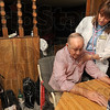 Tribune-Star/Joseph C. Garza<br /> Great home health care: VistaCare nurse Vicki Scheid, RN, CHPN, checks patient Joe Long's vital signs during a visit to his and wife Marjorie's home Friday.