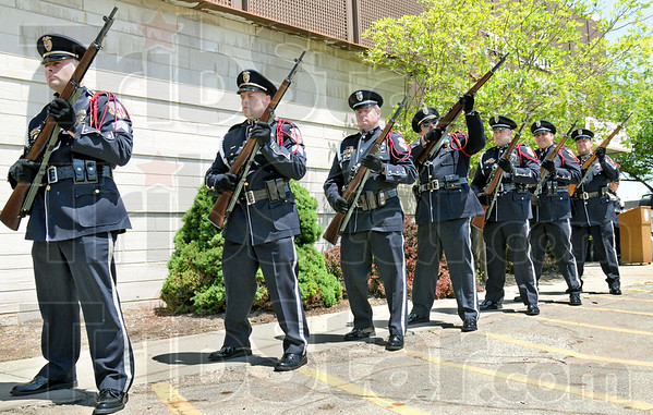 Salute: Members of the Terre Haute Police Department Honor Guard stand ready as they are called upon individually to fire a shot to honor the fallen police officers that have served the department during Monday's service.