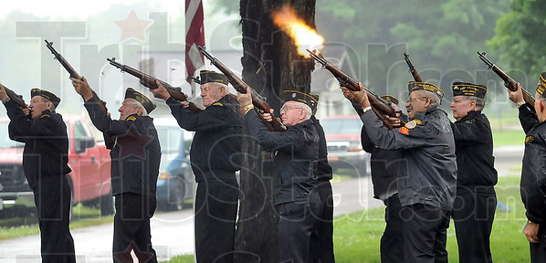 Tribune-Star/Joseph C. Garza<br /> Fire!: Members of the VFW Post 972 Color Guard fire their rifles for a 21-gun salute during the Memorial Day ceremony at Woodlawn Cemetery Monday.