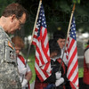 Tribune-Star/Joseph C. Garza<br /> Praying for the ones serving: Major Hal Johnston of the 76th Infantry Brigade bows his head as the chaplain of VFW Post 972 offers a prayer during a Memorial Day ceremony at Woodlawn Cemetery.