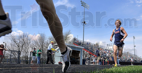 Tribune-Star file photo/Joseph C. Garza<br /> Staying close: Terre Haute North's Milton Brinza, right, trails the competition during the boys' 1600-meter run Saturday, April 18 during the Patriot Challenge at North.
