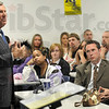 Tribune-Star/Joseph C. Garza<br /> Now Harrison College: Students of Harrison College, formerly Indiana Business College, and Old National Bank Vice President Brian Cain, second from right, listen as Ken Konesco, president and CEO of Harrison College, speaks about the college's name change Monday at the school.