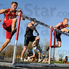 Tribune-Star file photo/Bob Poynter<br /> See you at the Big Four hurdles: South's Kenny Payne (L), South Vermillion's Russell Peelman and South's John Haley attack the first hurdle during Friday, April 17's South Invitational Track Meet. John Haley (R) was the eventual winner of the event.