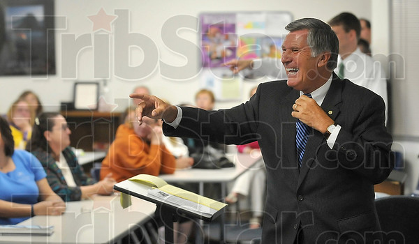 Tribune-Star/Joseph C. Garza<br /> A positive change: Ken Konesco, president and CEO of Harrison College, laughs with students in a room at the college Monday during a presentation about the school's name change.