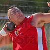Well put: Brave Josh Bridwell takes his turn at the shot put Tuesday evening.
