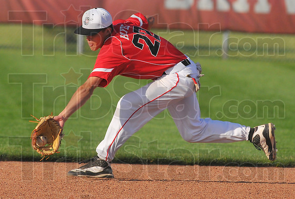 Good hands: Terre Haute South shortstop Jacob Hayes grabs a groundball in action against the Patriots.