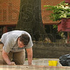 Tribune-Star/Joseph C. Garza<br /> Time for a familiar doodle: Rose-Hulman sophomore and West Vigo High School graduate Scott Gallmeier makes use of the chalk left out for students at the engineering school Tuesday to draw a character he has drawn since middle school.