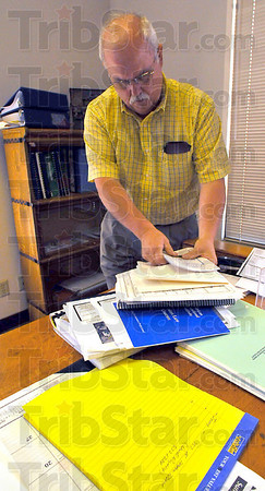 Moving in: Mike Ciolli moves paperwork into his new office in the Vigo County annex.