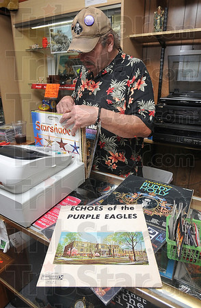 "Tribune-Star/Joseph C. Garza<br /> From the vault: Dennis Ross, a co-owner of Revolutions, displays a few LPs out of his private collection, including an album from Garfield High School, entitled, ""Echoes of the Purple Eagles,"" and a Buddy Holly disk among many others."