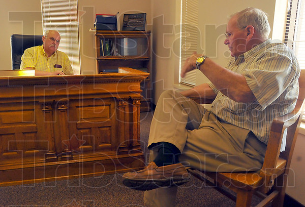 873 one way: New Vigo County commissioner Mike Ciolli talks in his office with county highway superintendent Jerry Lindsay about priorities and caring for the citizens who travel the 873 miles of county roads.
