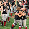 Celebration: Terre Haute South catcher #23, Tiffany Fendrick gets a hug from teammate #29 Kayla Price after they beat Martinsville Tuesday night in sectional action.