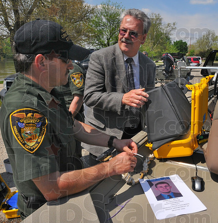 Looking: Indiana conservation officer Deland Szczepanski talks with Bill Mercier, Director of Security for ISU. Szczepanski and other officers had just finished a day of searching the Wabash River for signs of missing student Gerald Smith.