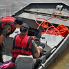 Searching: Indiana Conservation Officers Deland Szczepanski and Lt. Kent Hutchins  watch their sonar as they search the bottom of the Wabash River near the US 40 bridges. The are looking for signs Gerald Smith, the ISU student missing since Friday of last week.