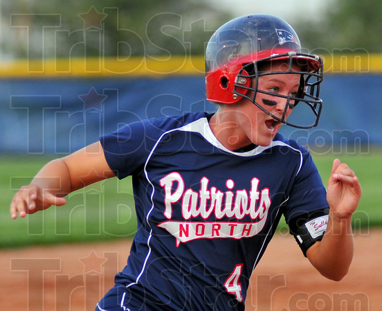 Coming home: Patriot Kelly Meggs shouts as she heads home thanks to teammate Kelsey Cofey's home run.