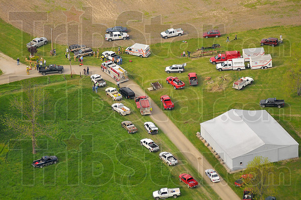 Staging area: Emergency vehicles wait a safe distance from the scene of the gas pipeline explosion in rural Parke county in western Indiana.