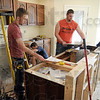 Kitchen work: James Burke, Justin Sipes and Cody Kraemer work as a team in the kitchen of a home under construction in Sugar Grove Estates Tuesday morning. They are participants in the Vigo County School Corporation Building Trades Program.