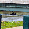 ON the river. Indiana conservation officers used sonar equipped boats to search the Wabash River Tuesday. The section searched was from the CSX bridge downriver to the I-70 bridges. Here they search in the shadow of the US 40 bridges.